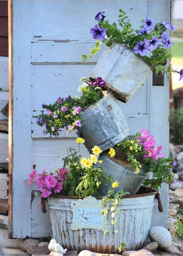 Primitive Tipsy Pot Planter | Incredible Tower Garden Ideas For Homesteading In Limited Space