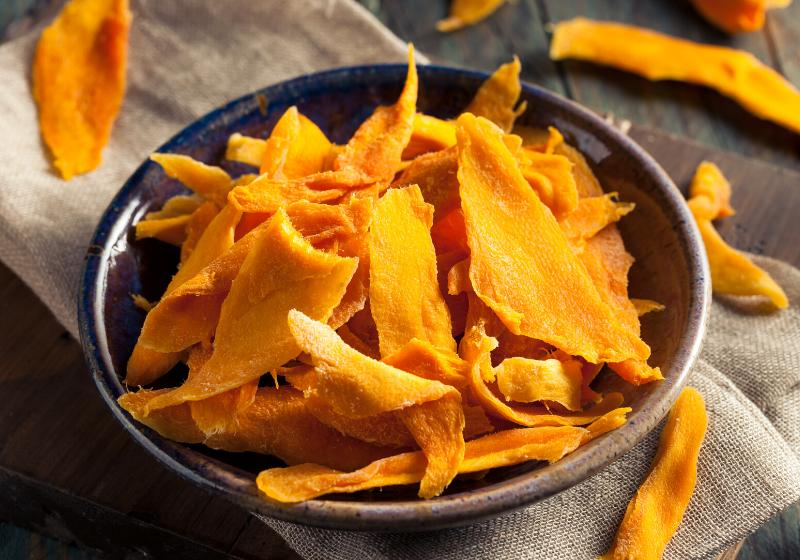 raw organic dried mangos bowl | dehydrating fruit times and temperatures