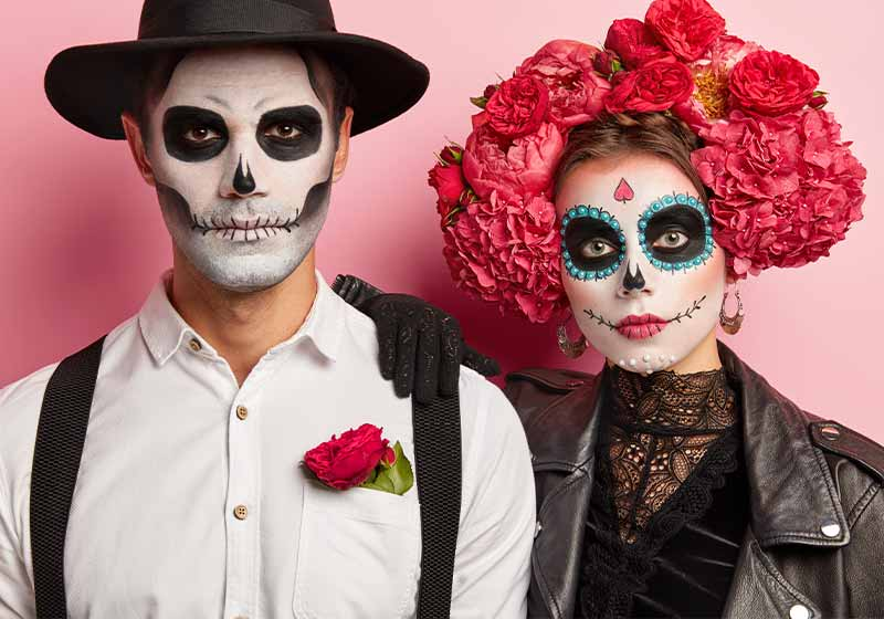 Serious woman and man have traditional mexican image, wear sugar skulls | scary costumes