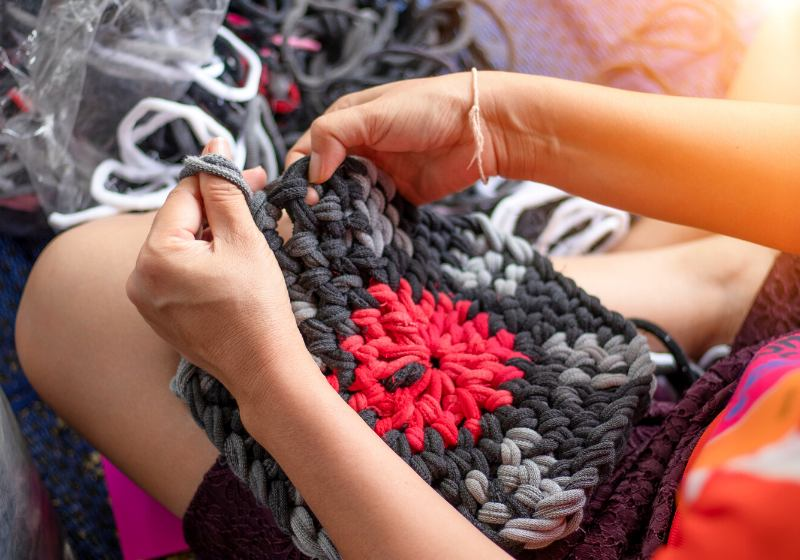 on selective focus middleaged women braided | braided rag rug