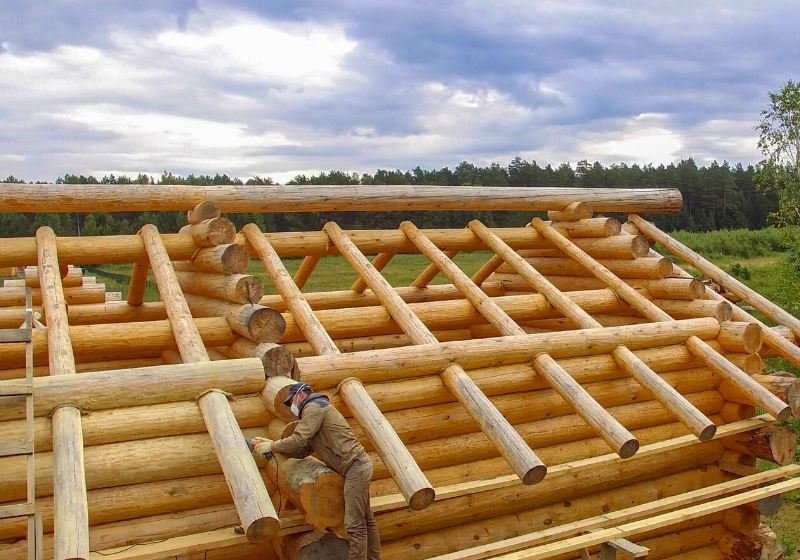 wooden log house under construction   easiest way to build a log cabin