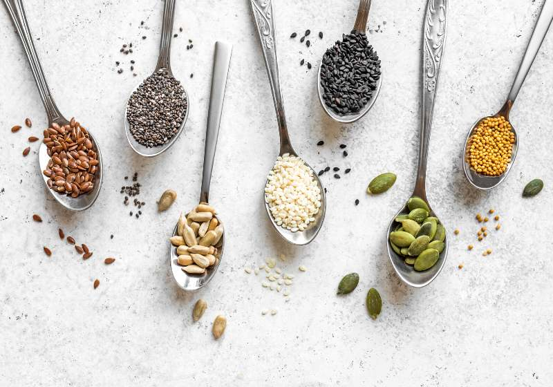 various seeds assortment on white background   plant based diet recipes
