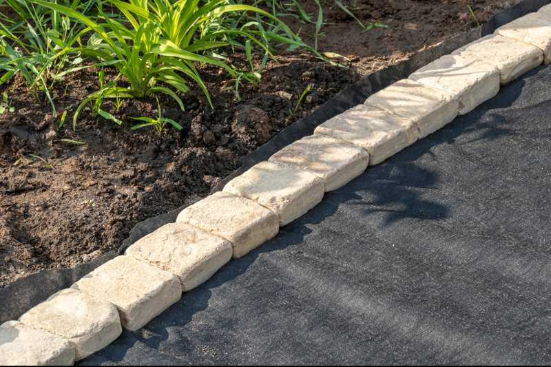 edging-laid-woven-geotextile-fabric-sandstone   duck ponds