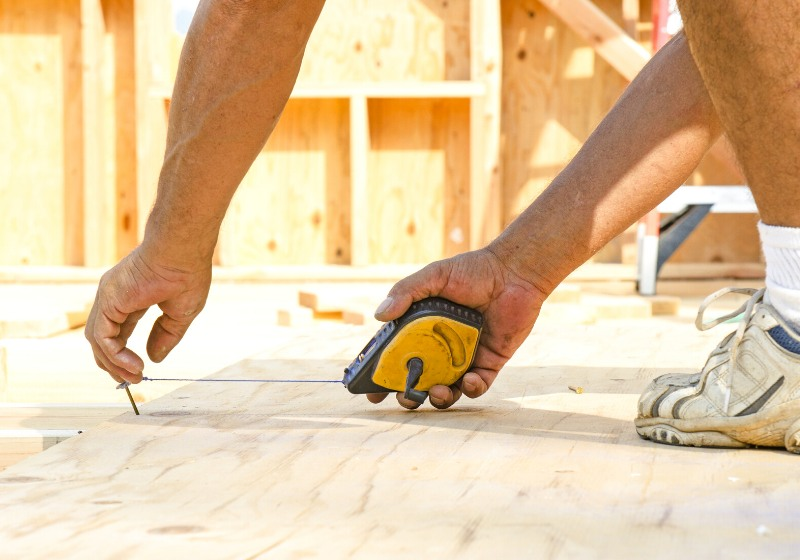 framing contractor measuring chalk line install | building a tiny house with no experience