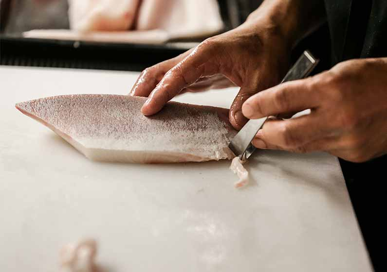 Scaling and removing bones from fillet of fish chef restaurant on white chopping board | how to fillet every fish