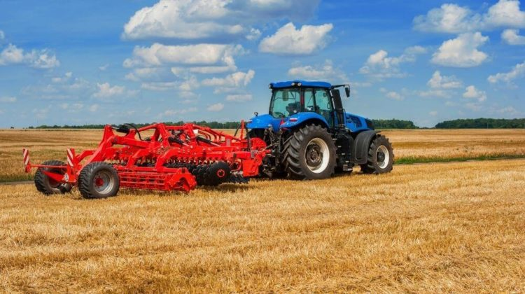 Blue tractor with pulls red harrow | 48 Tractor Accessories You Can Find On Amazon | Featured